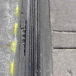 Expansion joints which keep water out of required movement joints in the structure can be damaged by a harsh winter and require proper repair to maintain watertight integrity.