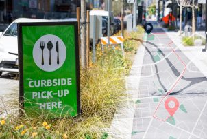 Photo illustration of curbside pickup in city with roadmap element