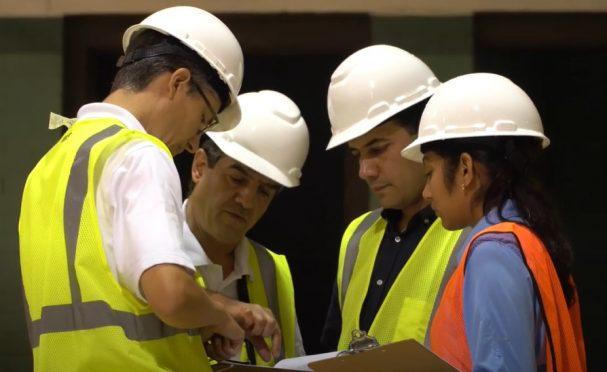 Walker employees conferring on a job site