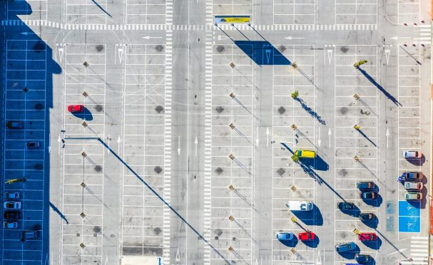 Mostly empty parking lot seen from overhead
