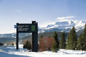 Dynamic sign outside Breckenridge, with mountain in background
