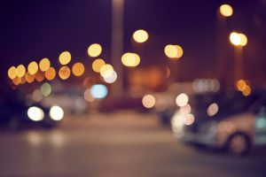 An urban parking lot at night, out of focus