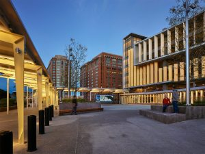 Pedestrian plaza in front of South Boston Waterfront Transportation Center at dusk