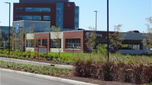 Parking structure at Mount Carmel Grove City with hospital in background