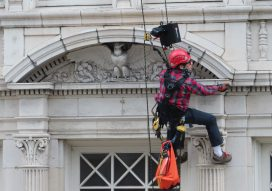 Rope access survey of a building with ornate terra cotta facade