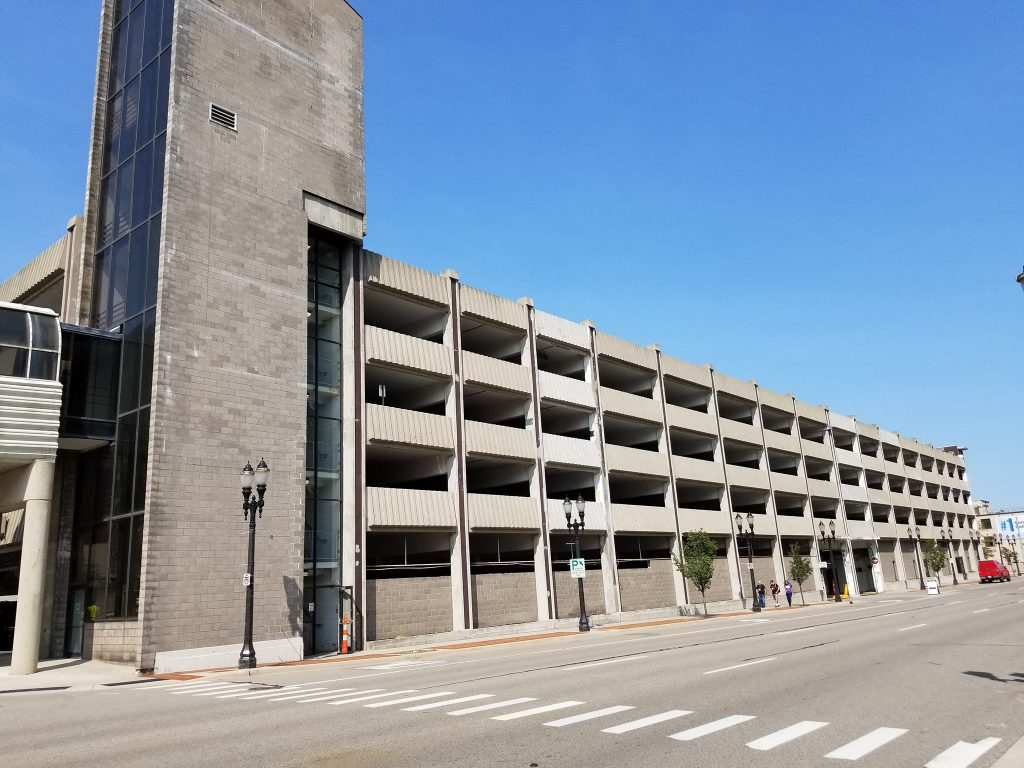 Exterior of aging concrete parking structure before renovation