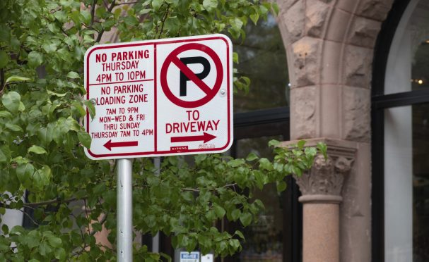 """Detail of """"No Parking"""" signs on a city street"""