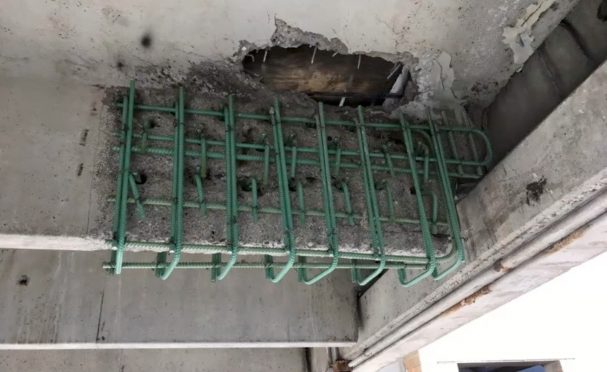 Repair of a failed precast double tee structural element in a parking structure