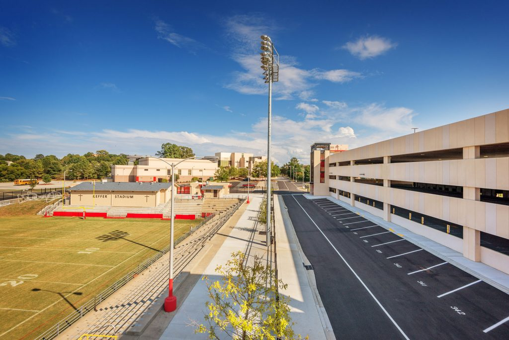 Exterior view of parking structure with adjacent football stadium