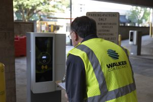 A Walker expert inspects parking access and revenue control equipment after installation