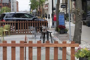 On-street parking spaces used for restaurant space in downtown Milwaukee