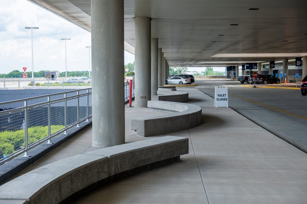 Curved benches for pedestrians outside the terminal at PTIA