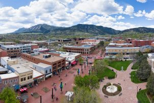 Downtown Boulder seen from above, including a park and street full of pedestrians